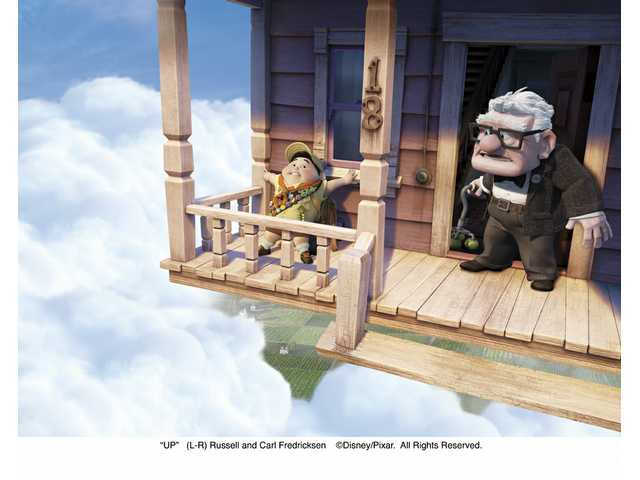 "Left to right, Russell and Carl Fredricksen, in the Disney/Pixar film ""Up."" The film is the latest released in 3D."
