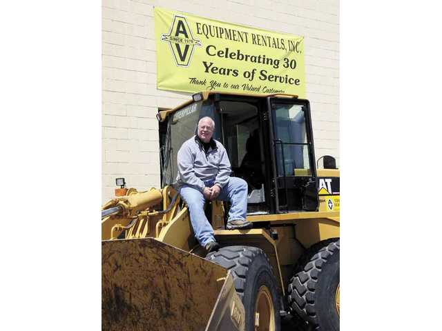 Don Cruikshank, owner of AV Equipment Rentals, sits atop one of the businesses skip-loaders available for rent. The company recently celebrated its 30-year anniversary.