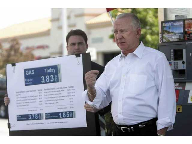 "At a Valencia gas station Wednesday, Congressman Howard ""Buck"" McKeon (R-Santa Clarita) blames Democrats for high gas prices."