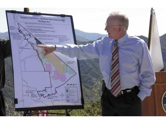 Congressman Buck McKeon describes the 42,000 acres around the Santa Clarita Valley that would be set aside in a bipartisan bill during a news conference Thursday.