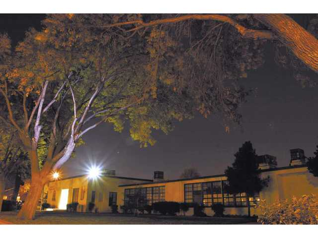 The file photo from November 2007 shows Newhall Elementary School after dark.