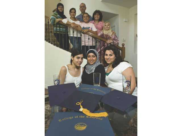 Alia Kalla, Tatiana Oueini and Hanadi Kalla celebrate their recent graduation from College of the Canyons with their family.