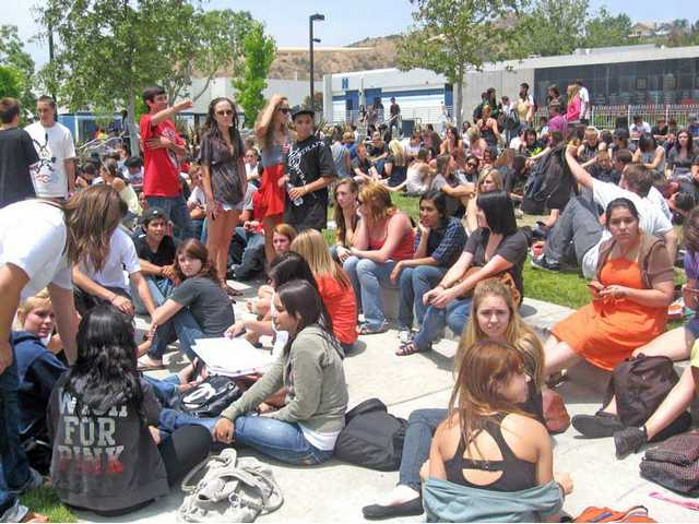Saugus High School students sat for hours in their campus quad to protest state budget cuts to education Monday morning.