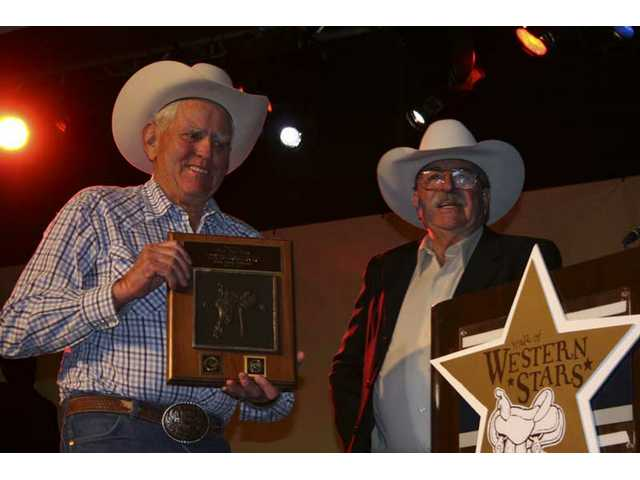Phil Rawlins shows off his Walk of Western Stars plaque, presented to him by longtime friend Jack Lilley during the official induction banquet at the Hyatt's Main Ballroom on Friday, April 27, 2007.