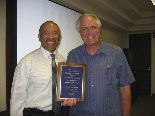 Valencia High School and Principal Paul Priesz (left) receive the Hart District's Valuing Diversity Award for the 2008-09 school year presented at an Administrative Council meeting by Diversity Coordinator Greg Lee.