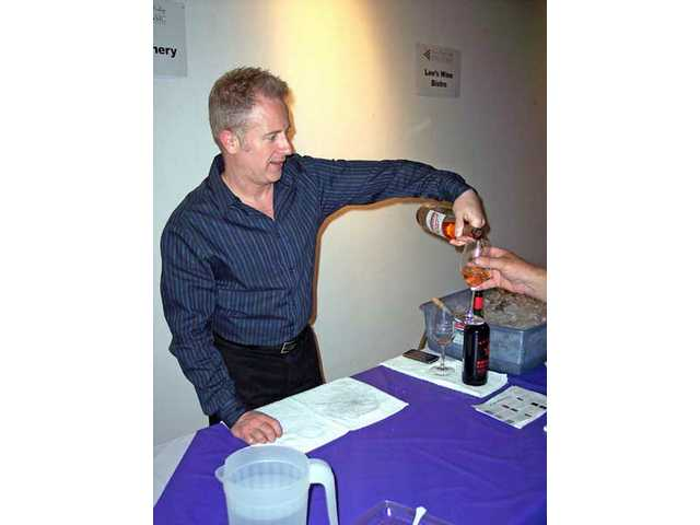 Lawrence Olive of Quady Winery pours a glass of wine.