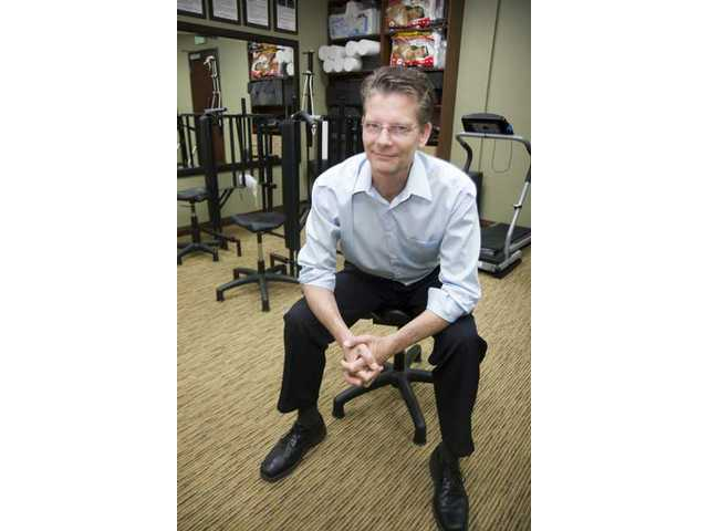 Chiropractor Stanley Henderson is one of the first businesses to move out of Spruce Street in Newhall, which will be the location of the future Newhall Library.