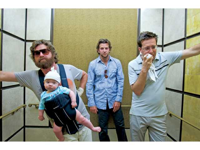 "Zach Galifianakis, left, Bradley Cooper, center, and Ed Helms are shown in a scene from ""The Hangover."