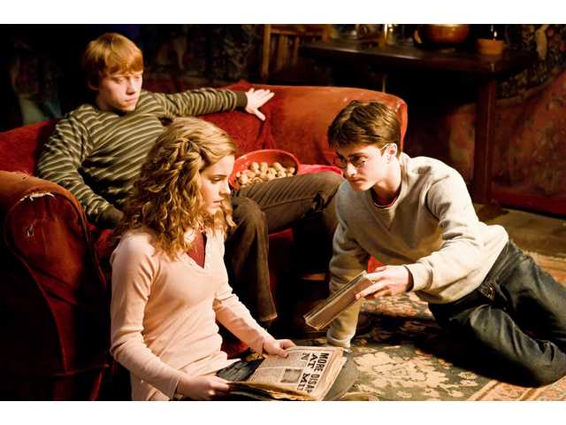 "Emma Watson as Hermione Granger, Daniel Radcliffe as Harry Potter and Rupert Grint as Ron Weasley in the fantasy adventure ""Harry Potter and The Half-Blood Prince."""