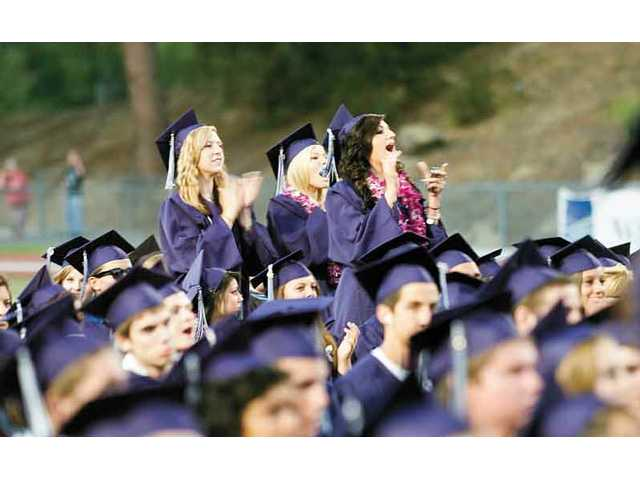 "Kellie Wesley, Heather Wilson and Lauren Stibelman cheer as Tamara Wurst senior class vocalist sings ""Whenever You Remember"" at the Saugus High School graduation. on Thursday night at the College of the Canyons."