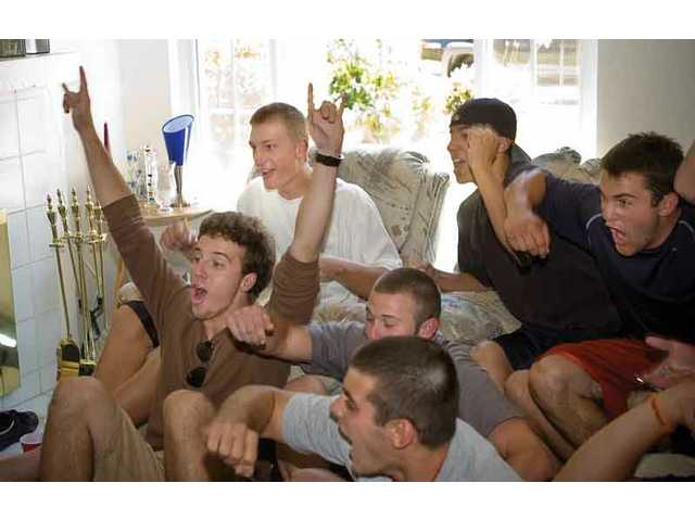 Hart High pitcher Michael Montgomery (back left) celebrates with friends Thursday afternoon at his house after being picked No. 36 overall in the Major League baseball draft by the Kansas City Royals.