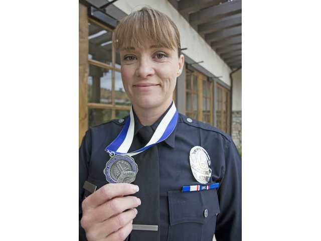 Los Angeles Police Sergeant Hayley Smith received a Medal of Valor for being one of several officers to run into a burning apartment building to evacuate residents in May 2008.