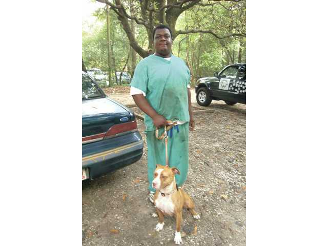 Keyon, a barbecue master at the Brick Pit in Mobile, Ala., was happy to pose with Loren. He has two pit bulls of his own.