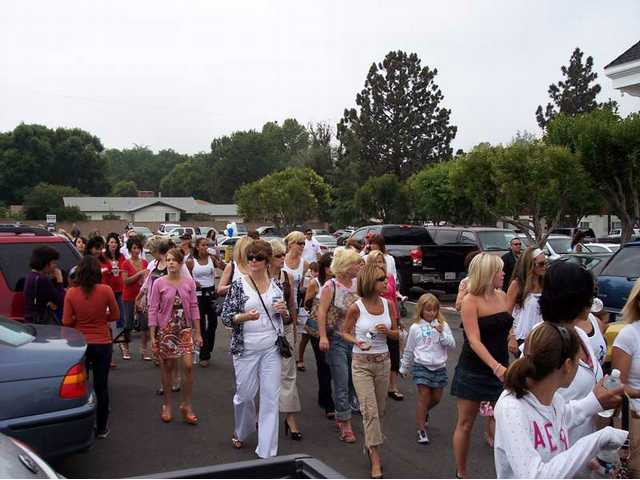 "The walkers of the High Heel-a-thon at the ""finish line"" in the parking lot of the businesses off Lyons Avenue and Walnut in Newhall."