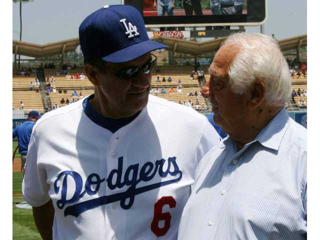 On SCV Dodger Day Saturday, former New York Yankees captain Joe Torre (left), in his rookie season as Dodgers manager, chats on the field with Tommy Lasorda, legendary Dodgers manager who's now special advisor to Frank McCourt, Dodgers owner/chairman.