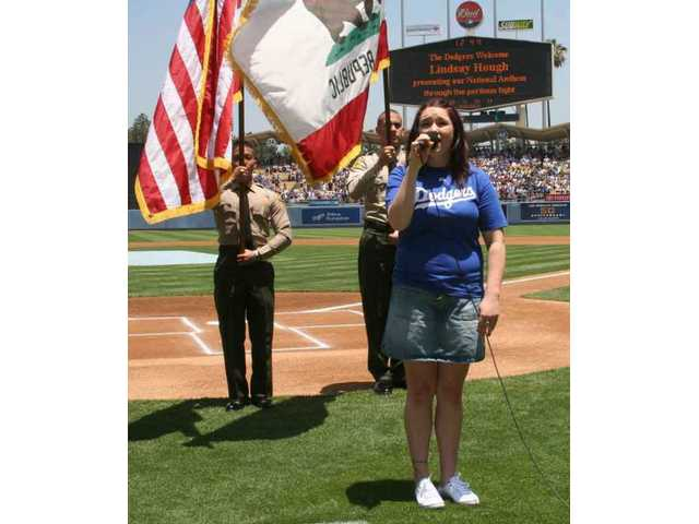 Hart High grad and Berklee School of Music student Lindsay Hough sings the National Anthem to cap SCV Dodger Day ceremonies Saturday at Dodger Stadium.