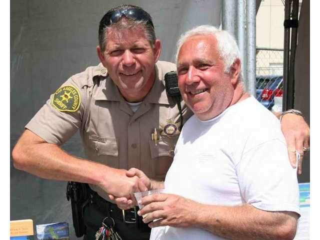 Artie Thompson of the SCV Sheriff's Station and Frankie Competelli became fast friends at the first SCV Italian Feast last year.