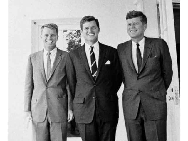 In this 1962 file photo of the three brothers, U.S. Attorney General Robert F. Kennedy, left, Sen. Edward M. Kennedy, D-Mass., center, and President John F. Kennedy pose at the White House in Washington.