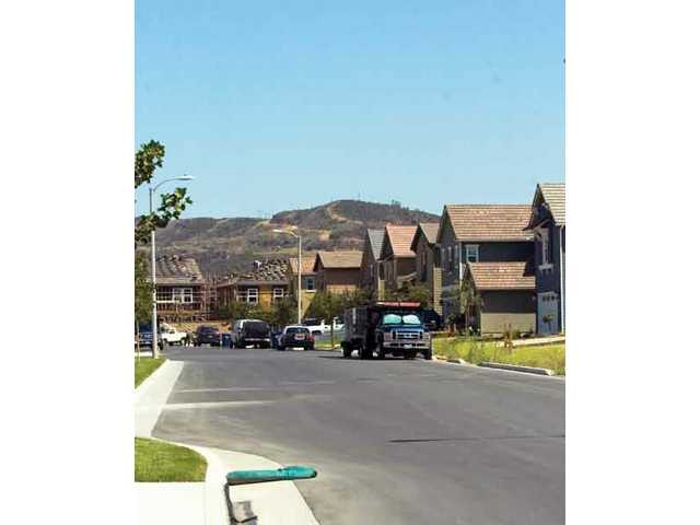 Despite the fact that Newhall Land's parent company, LandSource Communities Development LLC, is filing for Chapter 11 bankrputcy protection, it continues to develop new home sites such as this one in the River Valley Park Community on the Soledad Canyon Road corridor in Santa Clarita.
