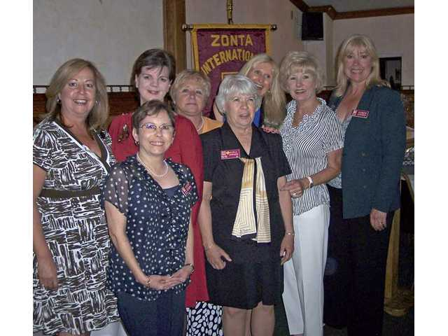 The 2009-10 Zonta Club of SCV officers installed during ceremonies at Le Chene French Cuisine, back row, left to right Secretary Susana Cornel, President Cindy Kittle, Immediate Past President Chris Miller, First Vice President Jorja Harris, installation committee chairwoman Jo Ann Rodriguez, Second Vice President Karen Maleck-Whiteley. First row, board member Alicia Estrada and President-elect Karla Edwards.