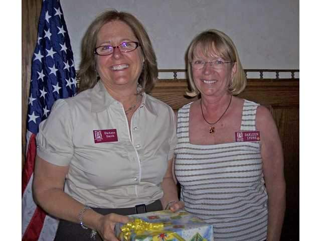 DaAnne Smith, left, was named winner of the Service Hours Award which was presented by Darleen Lyons.