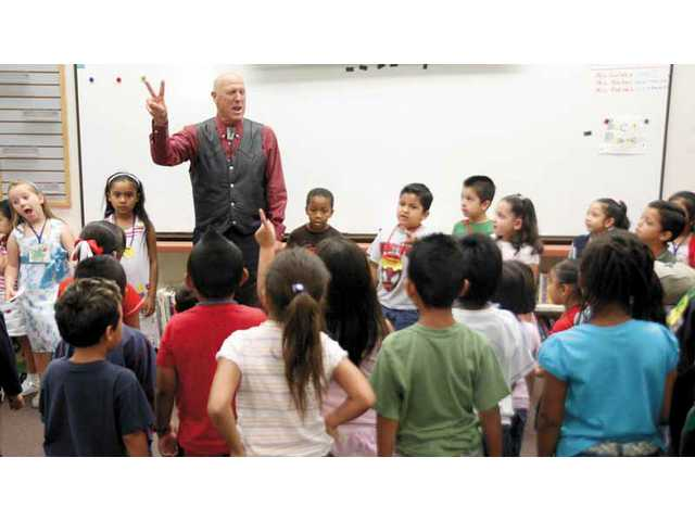 "Storyteller, James Cogan performs the story, ""Where is Barney Bear,"" with Canyon Springs Elementary students Tuesday morning.  The school's kindergarteners wrote and illustrated the Dr. Seuss-themed story."