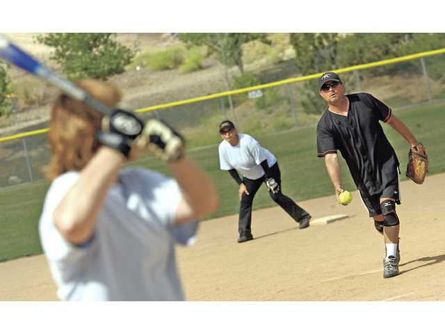 Frank DiAcri pitches.