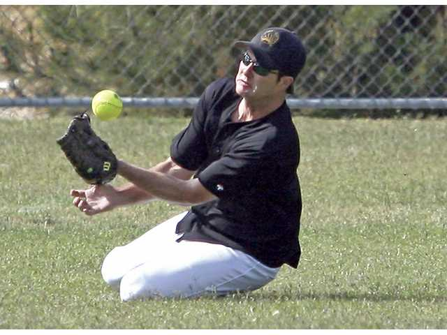 John Bratlein struggles with a tough fly ball in the outfield. (