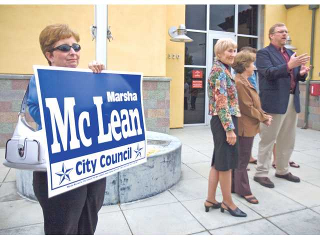 Diane Trautman, left, supports Marcia McLean Thursday afternoon outside Fire Station 126, as McLean along with Frank Ferry and Laurene Weste announce their bids for reelection in City Council 2010.