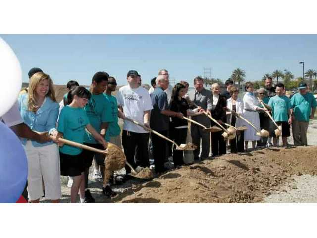 City of Santa Clarita officials and other dignitaries perform the traditional groundbreaking for the $25 million Phase 4 of the Santa Clarita Sports Complex Thursday morning.