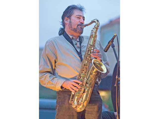 Dan Heffernan, who plays tenor sax for The Jeff Jensen Band, solos during Friday night's kickoff of the Lexus of Valencia Jazz and Blues Concert Series.