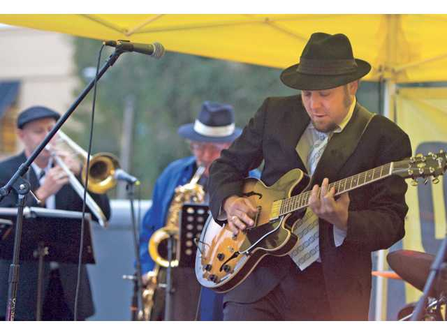 Jeff Jensen of The Jeff Jensen Band plays his guitar during the first day of the Lexus of Valencia Jazz and Blues Concert Series on Friday evening. The band kicked off the 11th year of the concert series at the Valencia Town Center.