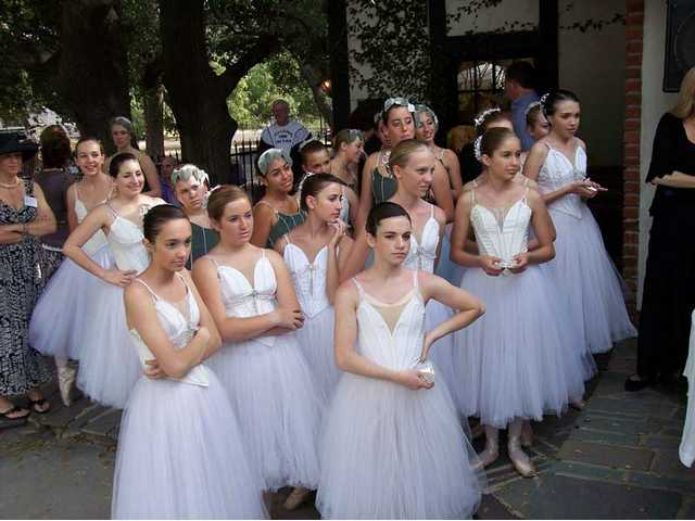 Members of the Santa Clarita Ballet Company wait to surprise little girls with tiaras and other treats at the annual Tippy Toes Tea. The event was held at the Placerita Canyon home of Ed and Wendy Winquest.