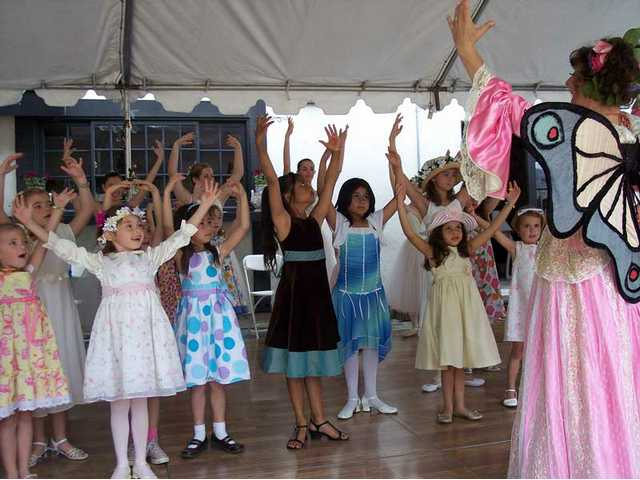 """Bloom"" (Robbi Morgan Walberg) gives a ballet lessons to girls attending the Tippy Toes Tea."