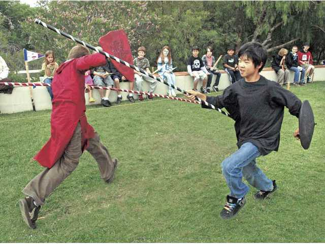 Santa Clarita Valley International Charter School seventh-graders Garrett Dougan, left, and Kenny Sogata, square off in a joust.