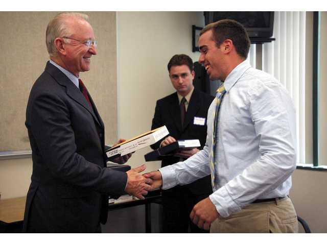 "Nicholas Jurado, 19, a Canyon High School graduate accepted into the U.S. Air Force Academy, receives a certificate and an American Flag from Congressman Howard P. ""Buck"" McKeon during the 2008 Academy Luncheon at City Hall on Saturday afternoon."