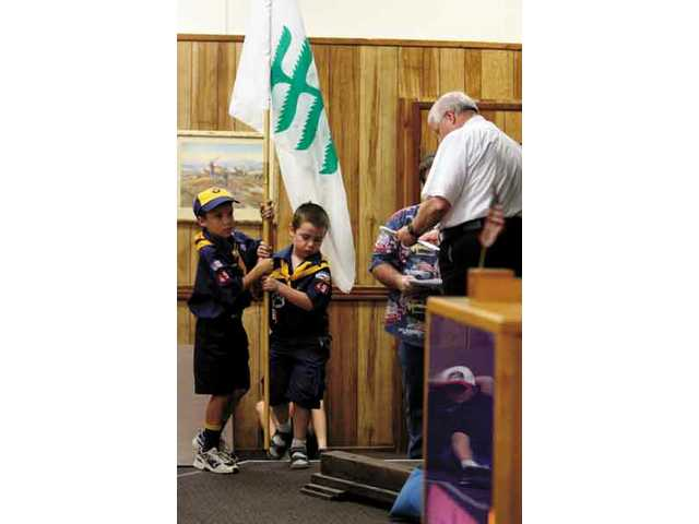 Stuart Blair, 7, and Benjamin Stanton, 6, from cub scout pack 494 in Canyon Country, carry a flag during a flag ceremony celebrated at the Elks Lodge Friday night.