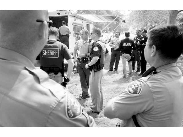 Los Angeles County sheriff's deputies gather at Hart Park in 2006 after a weapons threat at Hart High circulated on the Internet. Santa Clarita ranks as the ninth safest city in California, according to an FBI report.