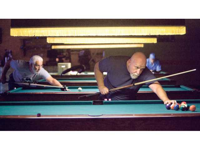 Competitors wage friendly pool game
