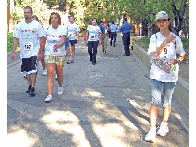 "Participants of the 2008 ""A Walk in the Park"" program trek across the theme park."