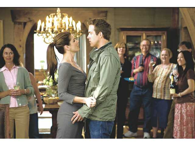 "Ryan Reynolds, center right, and Sandra Bullock, are shown in a scene from, ""The Proposal."""