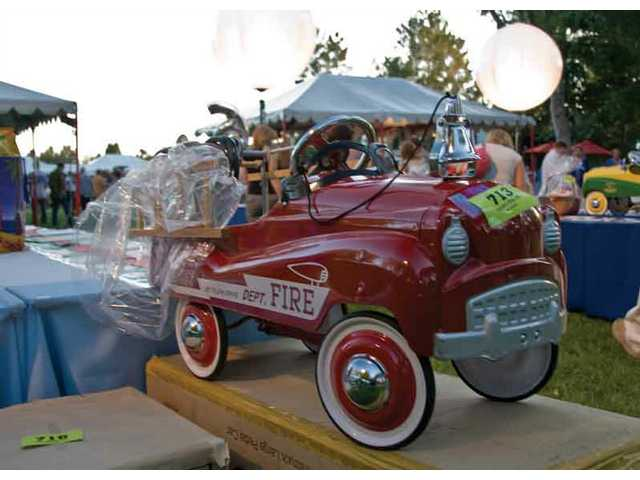 A vintage fire truck pedal car was one of the silent auction items.