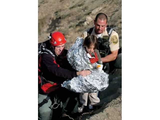 The Santa Clarita Valley Search and Rescue Team saves a child in April 2007. A golf  tournament fundraiser is planned for the team on Monday.