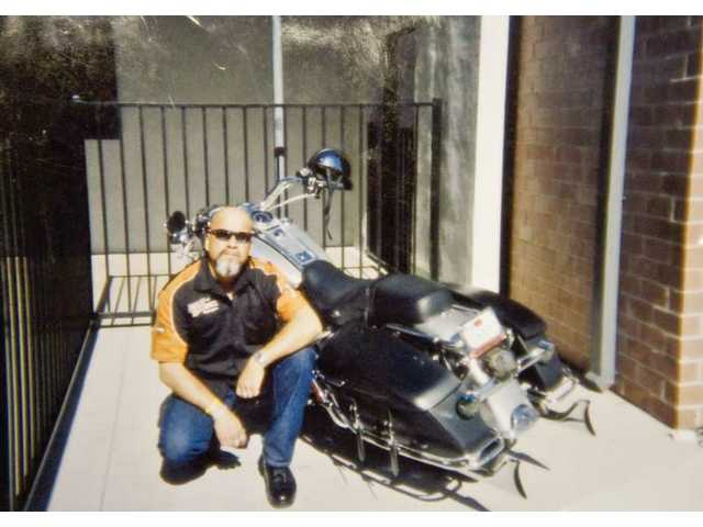 Vincent Renteria, a Hart High campus supervisor, died after a 3 1/2-year battle with brain cancer. He was known for his beloved Road King Classic Harley Davidson motorcycle.