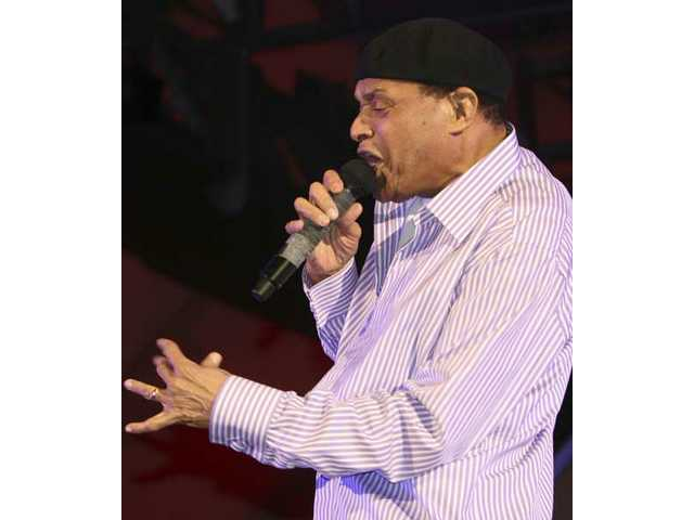 Jazz/pop legend Al Jarreau scats while playing air saxophone Saturday night during the Playboy Jazz Festival at the Hollywood Bowl.