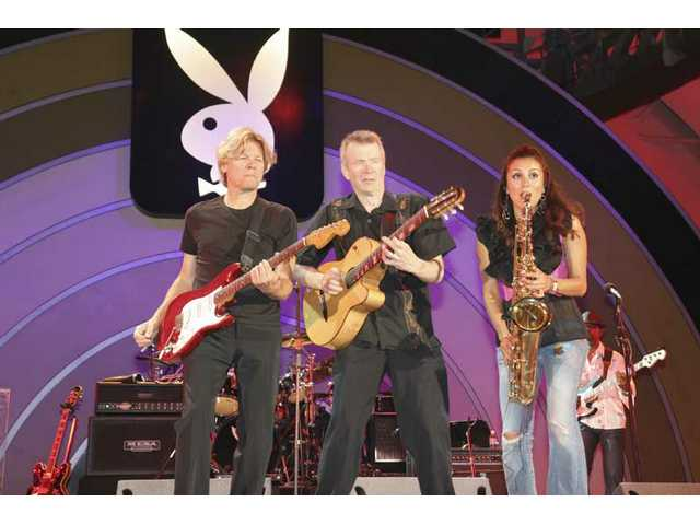 Jeff Golub, Peter White and Jessy J of Guitars & Saxes take the front line to exchange solos during the band's Playboy Jazz Festival set Father's Day weekend at the Hollywood Bowl.