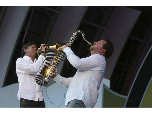 Trumpeter Rick Braun and tenor sax player Richard Elliot, teamed as R n R, worked the Hollywood Bowl audience into a frenzy Saturday evening at the 30th anniversary Playboy Jazz Festival.