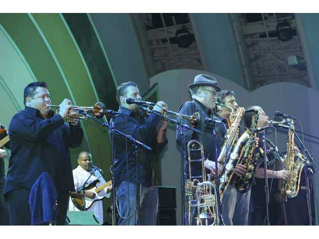 "Tower of Power's horn section was tight beyond tight at the Hollywood Bowl. They'd stop on a dime and give you nine cents change, to paraphrase a classic line (from ""Sneakers"") by Playboy Jazz Festival emcee Bill Cosby."