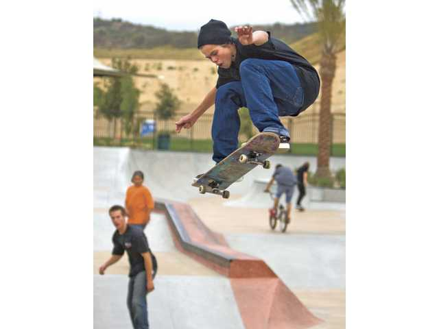 Fifteen-year-old Michael Wilson, of Valencia, gets some air on his skateboard at the skate park in the Santa Clarita Sports Complex.
