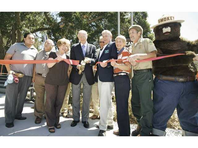 County Supervisor Michael Antonovich cuts the ribbon on the renovated Placerita Nature Center on Friday morning. The renovation cost $2.1 million and took about 18 months.